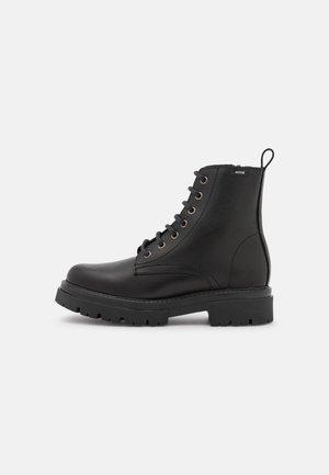 MERCURE - Platform ankle boots - black