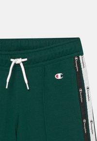 Champion - AMERICAN TAPE UNISEX - Pantaloncini sportivi - dark green - 2