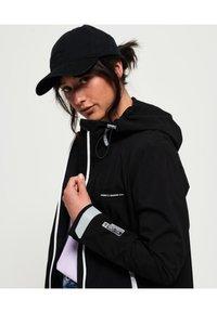 Superdry - HARPA - Waterproof jacket - black - 2