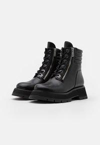 3.1 Phillip Lim - KATE LUG SOLE DOUBLE ZIP BOOT - Kotníkové boty na platformě - black - 2