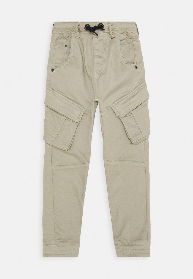 CALANDO - Cargo trousers - sand