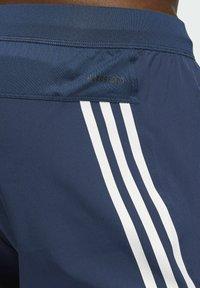 adidas Originals - AEROREADY STRIPES - Tracksuit bottoms - blue - 4