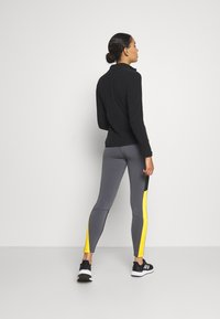 The North Face - STEEP TECH - Leggings - Trousers - vanadis grey/black/lightning yellow - 2