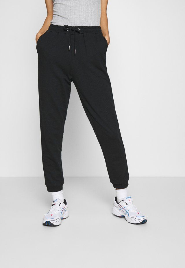 REGULAR FIT JOGGERS - Verryttelyhousut - black