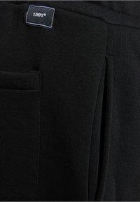 Bershka - UNISEX WIDE FIT - Pantaloni sportivi - black - 5