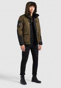 khujo - NANDU - Winter jacket - oliv-schwarz kombo - 4