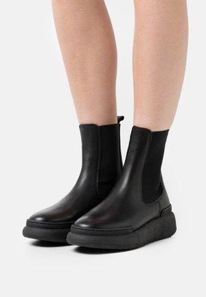 SIGNE - Platform ankle boots - black