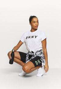 DKNY - EXPLODED LOGO BOXY TEE - Print T-shirt - white - 1