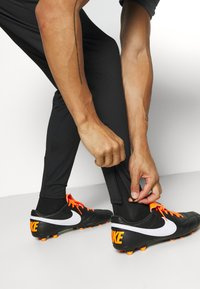 Nike Performance - DRY STRIKE PANT - Tracksuit bottoms - black/smoke grey/black/volt - 3