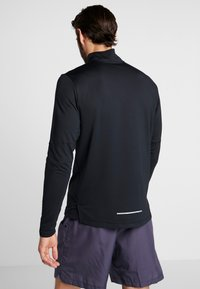Nike Performance - T-shirt de sport - black/reflective silver - 2