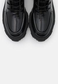The Kooples - BOTTINE AVEC GROSSE SEMELLE - Platform ankle boots - black - 6
