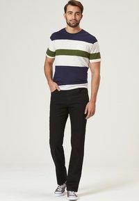 Pioneer Authentic Jeans - HERREN MEGAFLEX RANDO - Straight leg jeans - black - 1