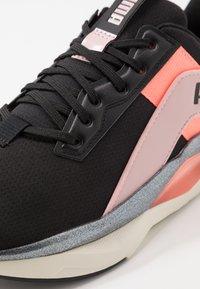Puma - LQDCELL SHATTER XT GEO - Sports shoes - black/peachskin/peach - 5