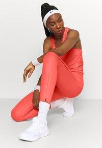 Nike Performance - MILER TANK RACER - Sportshirt - bright mango/reflective silver - 3