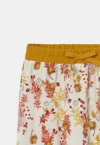 Müsli by GREEN COTTON - CALENDULA VOLUME BABY - Trousers - cream - 2