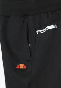 Ellesse - VIGOLO TRACK PANT - Trainingsbroek - black - 3