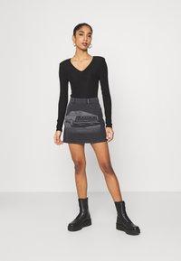 NU-IN - LASER PRINT MINI SKIRT - Mini skirt - black - 1