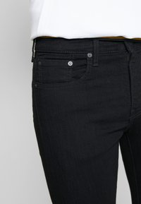 Levi's® - SKINNY TAPER - Jeans Skinny Fit - black denim - 3