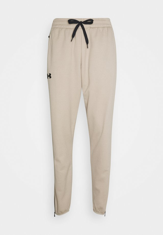 TEXTURED PANTS - Tracksuit bottoms - highland buff