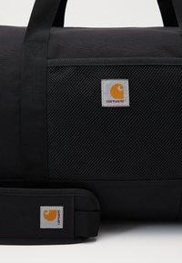 Carhartt WIP - WRIGHT DUFFLE BAG - Sports bag - black - 3