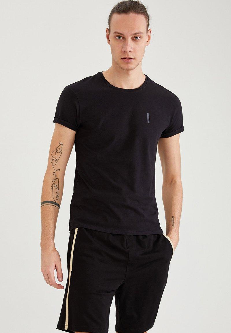 DeFacto - Pantaloncini sportivi - black
