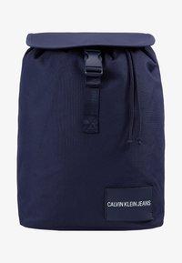 Calvin Klein Jeans - LOGO TAPE FLAP BACKPACK - Rucksack - blue - 1