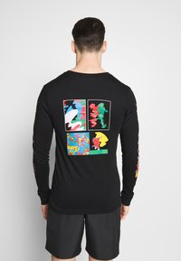 Nike Performance - M NK DRY TEE LS A.I.R. A SAVAG - T-shirt de sport - black - 2