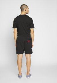 Nike Sportswear - Træningsbukser - black/white - 2