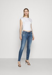 Tommy Jeans - Basic T-shirt - white - 1