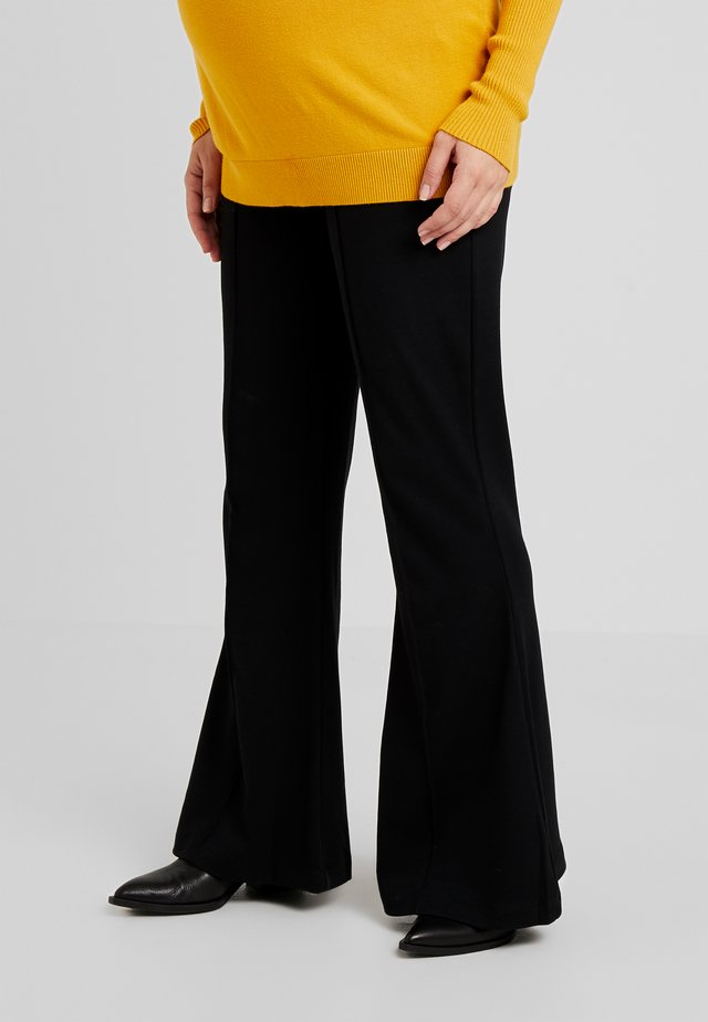 ONCE ON NEVER OFF FLARED PANTS - Trousers - black