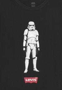 Levi's® - STAR WARS STORM TROOPER UNISEX - T-shirt print - black - 2