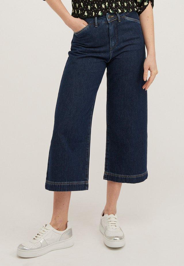 Jeans a zampa - bleu