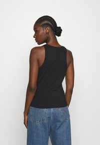 Calvin Klein Jeans - SHINE LOGO RACER BACK - Top - black - 2
