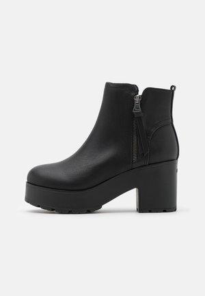 EMELINE - Platform ankle boots - black