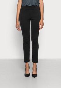 Opus - ELOTTI - Leggings - Trousers - black - 0