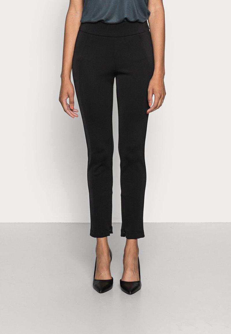 Opus - ELOTTI - Leggings - Trousers - black