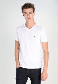 Lacoste - T-shirt - bas - white - 0