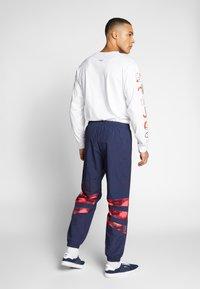 adidas Originals - FOOTBALL GRAPHIC TRACK PANTS - Tracksuit bottoms - blue - 2
