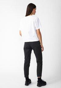 ARMEDANGELS - CAJAA - Slim fit jeans - black - 2