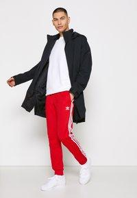adidas Performance - URBAN RAIN.RDY - Waterproof jacket - black - 1