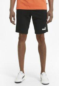 Puma - Sports shorts - puma black - 0