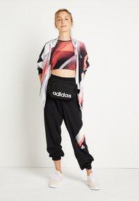 adidas Performance - Tracksuit bottoms - black/white/white - 1