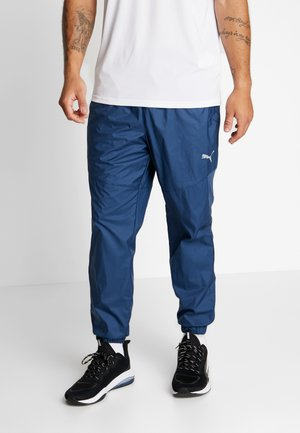 REACTIVE PANT - Tracksuit bottoms - dark denim