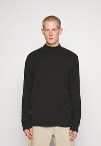 Weekday - DORIAN TURTLENECK - Long sleeved top - black - 0