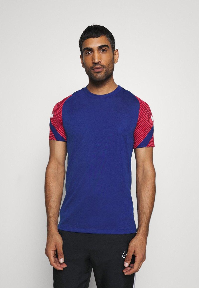 Nike Performance - DRY STRIKE - Camiseta estampada - deep royal blue/dark beetroot/white
