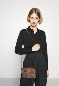 By Malene Birger - CODIA - Pantalon classique - black - 3