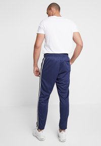 Nike Sportswear - PANT TRIBUTE - Tracksuit bottoms - midnight navy/white - 3
