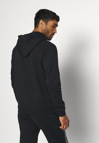 Under Armour - RIVAL  - Zip-up hoodie - black/onyx white