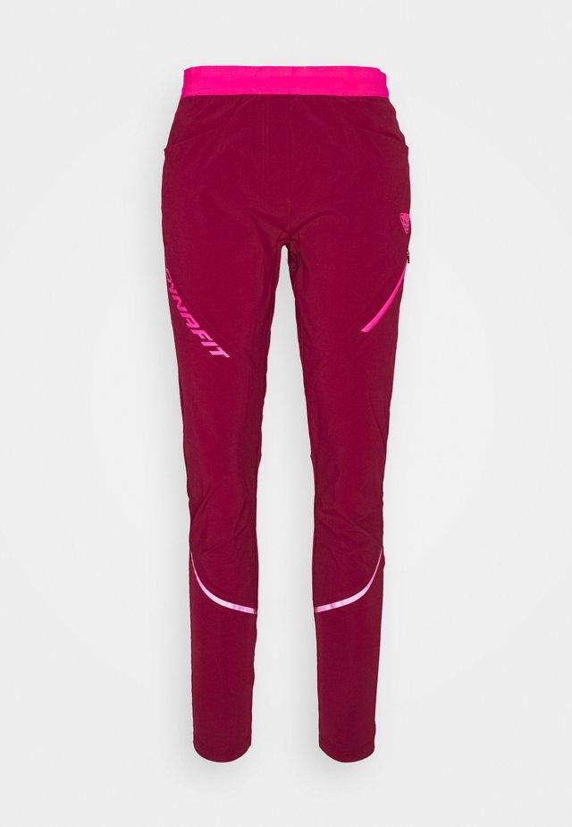 TRANSALPER HYBRID - Spodnie materiałowe - beet red