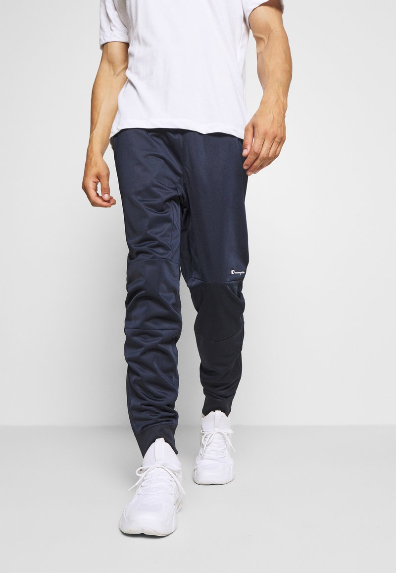 Champion - LEGACY CUFF PANTS - Tracksuit bottoms - dark blue